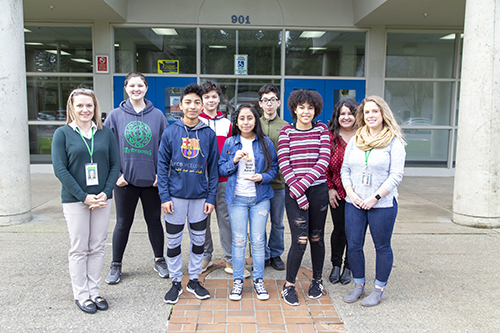 students and staff with gold star trophy