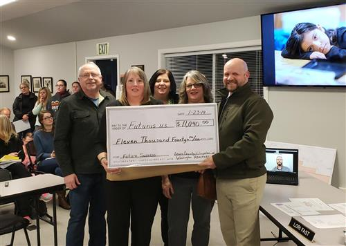 Donation at board meeting with large sample check