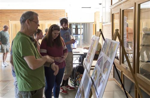 Visitors take a look at plans for the modernized CHS